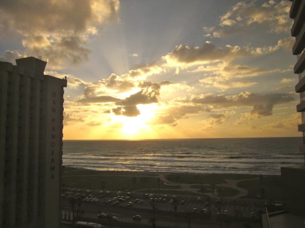 This is the view from my hotel room, as the sun sets in the distance and goes to greet my wife and Abby!